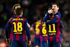 Lionel Messi (R) of FC Barcelona is celebrates with his teammates after scoring his team's first goal during the La Liga match between FC Barcelona and RCD Espanyol at Camp Nou on December 7, 2014 in Barcelona, Catalonia.