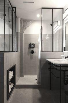 black and white bathroom, black metal framed glass dividers, Ace Hotel LA | Remodelista