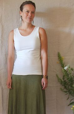 Our Reversible Scoop Tank features a feminine scooped back, or front! Crafted from our lightweight stretch blend of hemp, organic cotton, and 3% lycra, this stretchy tank is fully reversible. A great warm weather piece that can be layered in the color months. Flatteringly fitted. Shown in color Cloud (undid).  SIZING:  The designs of our clothing are flattering and easy to wear. Keep in mind that if you are usually, say, a size small, you probably will be in our shop as well. The sizing…