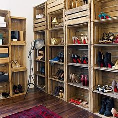 Recycled wooden crates stacked to create a shelving system have been cleverly used as shoe storage in this bedroom. The dark wooden floor and traditional red rug add to the vintage feel. - LOVE this idea for shoe storage! Pallet Crates, Wooden Crates, Wine Crates, Pallet Boxes, Wood Pallets, Vintage Crates, Pallet Wine, Diy Pallet, Pallet Closet