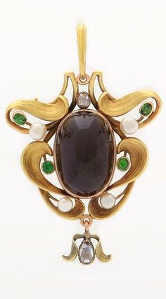 Art Nouveau pendant in yellow gold set with a cabochon garnet surrounded with demantoïd garnets, pearls and rose cut diamonds, Faberge circa 1900,stamped Karl Fabergé and Victor Aarne.
