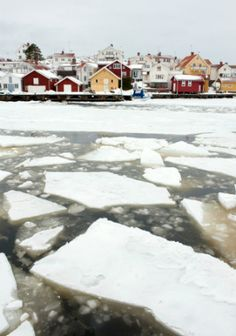 Southwestern Sweden: Icebound harbour. I love the buildings in traditional yellow and red ochre paint.