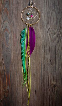 I need to figure out how to make my own dreamcatcher like this (this is an earring) and ask my friend samantha to buy some feathers from her :)