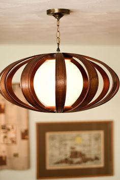 On the fence about this Danish light. I love the bent wood; but I'd probably mount it LOW on a thin, long brass pendant rod in a corner with a pair of scoop chairs straddling a teak root block.