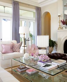 Sunroom - Matching brown velvet ottomans are tufted. Love the pillow and chair fabrics, especially paired with the curtain color.