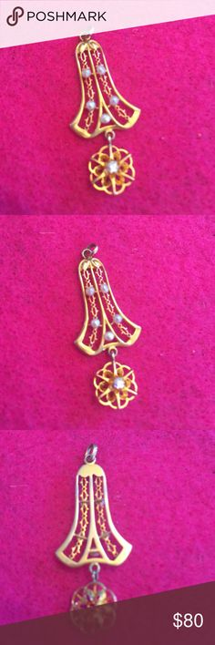 Pearl and diamond lavalier Bell shaped gold lavalier has small seed pearls, the circular dangle had a diamond chip in its center. Jewelry Necklaces