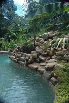 Hidden slide and tropical pool!  #swimmingpool