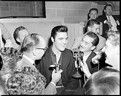 Elvis - Vancouver 1957, Elvis Presley with a CKNW reporter  |    Photo credit: The Province Newspaper