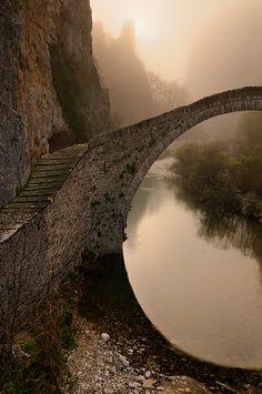 Single arched stone bridge of Kokkorou, Epirus, Greece. I lived in Greece for a short time as a teenager, but didn't get to see all of it. Oh The Places You'll Go, Places To Travel, Places To Visit, Beautiful World, Beautiful Places, Simply Beautiful, Romantic Places, Camera World, Belle Photo