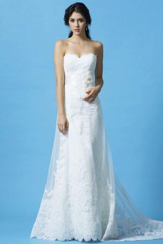 STYLE: GL024              Strapless gown in Royal Duchess Satin with Lace overlay and scalloped sweetheart neckline. The ribbon belt and handcrafted flowers accent the natural waist and finished with a chapel length train. Available in White or Ivory. The belt can also be ordered separately. (See BLT043)