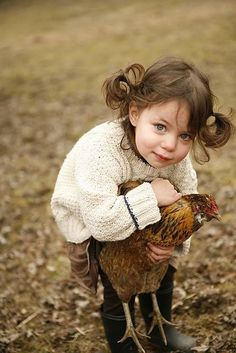 Little girl and her chicken