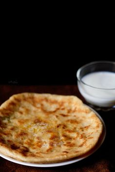 aloo kulcha are crisp as well as soft leavened breads stuffed with a spiced potato filling. kulcha is very popular in delhi and the state of punjab.