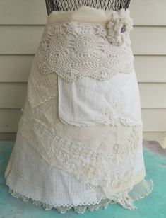 Layered vintage linens hidden pocket apron with flower pin