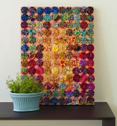 Got an old cork board or an old canvas you'd like to cover? Prime and paint your canvas and get out all of those old yo yos you made! Glue the yo yos in a great color pattern you love and there you have it! A wonderful piece of art. Don't forget to use a Sew-EZ Fingerthing to bond your yo yos down!!