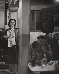 Accordionist Playing in a Bistro near Les Halles, Paris by Robert Doisneau, circa 1950