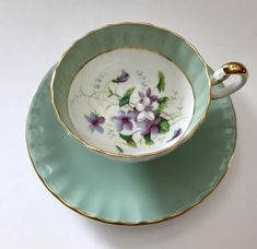 Vintage Aynsley china tea cup and saucer, made in England. Lovely sage I am with purple violets on both the cup and saucer. It is in good condition, no chips, cracks or crazing and both pieces ring nicely. Please Note: The items I sell are not new, they are vintage or antiques,