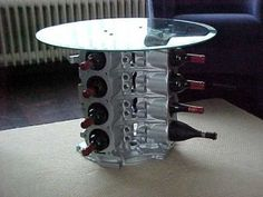 Car Part Upcycle: Engine Block Table / Wine Bottle Holder - Upcycle Car Parts - Reuse Recycle Repurpose DIY DIY using parts from Cars, Motorcycles, Trucks, and more. -- Pin shared by Automotive Service Garage in Sarasota, FL -https://www.facebook.com/AUTOREPAIRSARASOTA