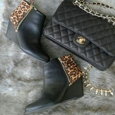 """Black and animal booties ***Sz6.5, but run more like a 6.*** EUC Worn once for a couple hours. Only flaws seem to be to the inside of left bootie...a smudge and small scratch, not noticeable. About a 4"""" wedge heel. On trend and very versatile! Report Shoes Ankle Boots & Booties"""