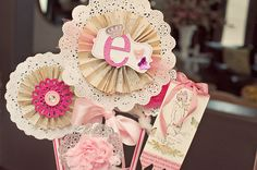 doilies + old book paper rosettes + glittery embellishments