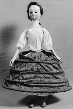 Here are the doll from the MFA's little undergarments.  I don't see stays, but she has her shift and hooped petticoat.