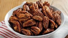 Rosemary provides an aromatic addition to these baked pecans - perfect to serve as snacks.