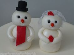 Hand crafted edible sugar snowman bride & groom christmas wedding cake topper 15 UK pounds+ Keywords: #weddings #jevelweddingplanning Follow Us: www.jevelweddingplanning.com  www.facebook.com/jevelweddingplanning/