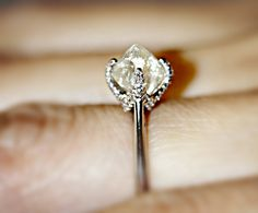check out the unique 4-prong design of this Signature ring that hugs this stunning uncut diamond