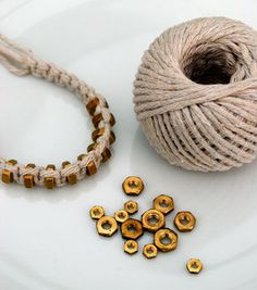 {Macramé: square knot} string & hexnut bracelet .  Free tutorial with pictures on how to make a rope bracelet in under 30 minutes by jewelrymaking with string and hexnut. How To posted by Kate L. Difficulty: Simple. Cost: Cheap. Steps: 4
