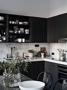Grey home with a black kitchen - via Coco Lapine Design Kitchen, ideas, diy, house, indoor, organization, home, design, cook, shelving, backsplash, oven, desk, decorating, bar, storage, table, interior, modern, life hack.