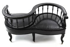 Ebonized Courting Chair Loveseat with frame done in black lacquer and with upholstery done in a high sheen richly textured black leather.