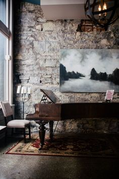 rustic brick wall and piano; landscape painting