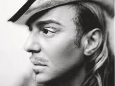 John Charles Galliano CBE, RDI is a Gibraltar-born British fashion designer who was the head designer of French fashion companies Givenchy, Christian Dior, and his own label John Galliano.