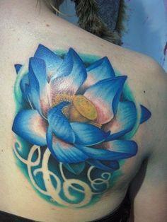 Blue Ink Lotus Flower Tattoo On Back Shoulder