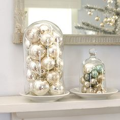 Fill a glass cloche with ornaments