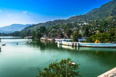 Bhimtal is a lake city named after Bhima, the charismatic mythological character of Mahabharata. The lake is at a scenic spot with a small island at its centre on which there is a beautiful large aquarium which was previously a restaurant. Tourism India, India Travel, Nainital, Hill Station, Best Resorts, Adventure Activities, Winter Travel, Amazing Destinations, National Parks