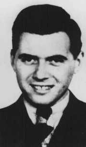 This is a picture of Dr. Josef Mengele who was nicknamed the Angel of Death for the atrocities he committed to Nazi prisoners in WWII. He is known for selecting who lived and who was gassed when prisoners entered Auschwitz. Lastly, he is infamous for experimenting on prisoners.