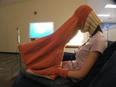 """""""Bekathwia invented the knitted Laptop Compubody Sock. It's a fabric tube that covers your head while letting you see  your laptop screen. There are even hand-holes so that you can continue to type comfortably while sucking up all of the privacy in the room."""""""
