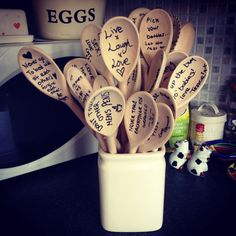 Hen do keepsake. Get all the hens to write a recipe to a good marriage on a wooden Spoon and give the bride a gift for life.