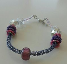 Check out this item in my Etsy shop https://www.etsy.com/listing/225960637/ladies-braceletsbeaded-viking-knit