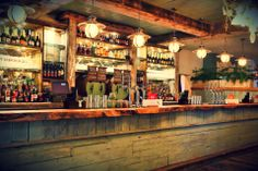 Back Bar Designs | the botanist alderley bar chandelier made from an old rusty wheel and ...
