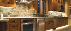 accent lighting on floor and below cabinets. Both add a lot to the feel. - Barrett