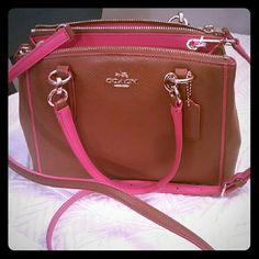 "NEW Coach mini christie crossbody Beautiful two toned color (saddle and dahlia) with three compartments. Two top zip closures and middle snap closure. Approx measurements 11"" (L) x 7"" (H) x 4"" diameter. 6"" drop. Perfect for spring and summer! PRICE FIRM. This purse has been listed as high as $350. Poshmark needs to take its cut, too so I can't go any lower. This is one of the very latest styles this season and it looks even better in person! Pic 2 just to show versatility, not the same…"