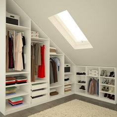 built-in walk in wardrobe gray parquet at roof sloping open shelves - in…