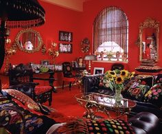 "When she was putting together her New York loft, ANNA SUI found inspiration in books on English houses. ""All my favorites had red rooms,"" she says. For the living room, the fashion designer incorporated gilt-metal furnishings, Polish majolica, pillows and other treasures found in flea markets and antiques shops. (October 1994)"