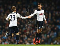 MANCHESTER, ENGLAND - JANUARY 21: Dele Alli of Tottenham Hotspur (R) celebrates scoring his sides first goal with Christian Eriksen of Tottenham Hotspur (L) during the Premier League match between Manchester City and Tottenham Hotspur at the