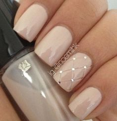 Nude with feature studded nail