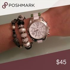 "Price Drop!⬇Layered Watch & Bracelet Set Silver and white boyfriend watch. Still works with a face size of about 1.5"" Black and white Pandora inspired charm bracelet with rhinestone accented beads. Please note the one rhinestone bead is missing about 3 stones. Zoomed in photo is provided, but you cannot tell unless specifically looking up close. Black, silver and white toggle bracelet with iridescent white bead accents.  This is an awesome set for that layered look to spice up any outfit…"