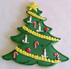 Adorable Christmas tree cookie with candles and candy canes