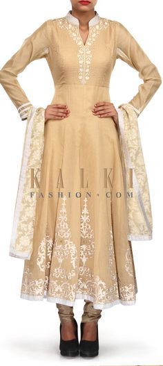 Buy Online from the link below. We ship worldwide (Free Shipping over US$100). Product SKU - 304323.Product Link - http://www.kalkifashion.com/beige-anarkali-suit-embellished-in-resham-embroidery-only-on-kalki-18569.html