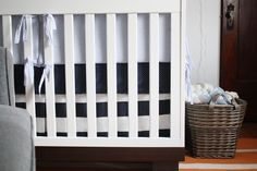 handsome navy & white striped #fabric covers crib mattress perfectly for Henry's Nursery. Fabric: Banda ( http://www.tonicliving.com/Banda-Navy-P2403.aspx ) via @Project Nursery | Junior